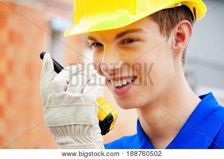 apprentice / trainee. construction workers on site with hey