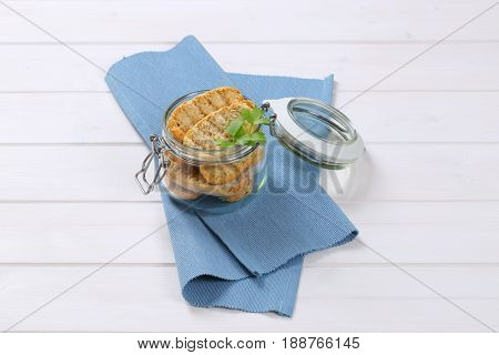 jar of crispy rusks on blue place mat