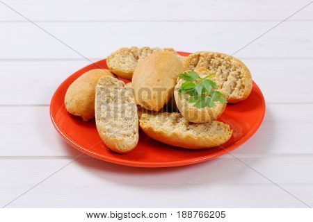 plate of crispy rusks on white wooden background