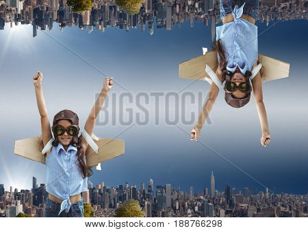 Digital composite of up side down city. sky background girl want's to fly