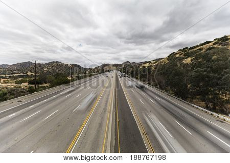 Ten lane 118 freeway with motion blurred vehicles in the San Fernando Valley area of Los Angeles, California.