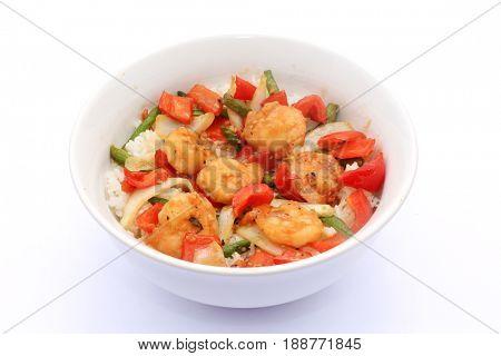 Shrimp and vegetables bowl on steamed white rice.