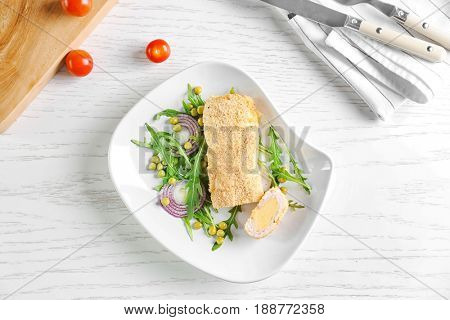 Delicious Cordon Bleu chicken on plate, top view
