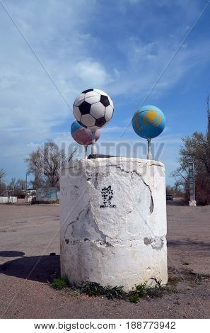 Street decoration.Satellites made from missle high pressure air tanks in colors Russian and Kazakh flags.Former Soviet anti-ballistic missile testing range Sary Shagan.May 6, 2017.Priozersk.Kazakhstan