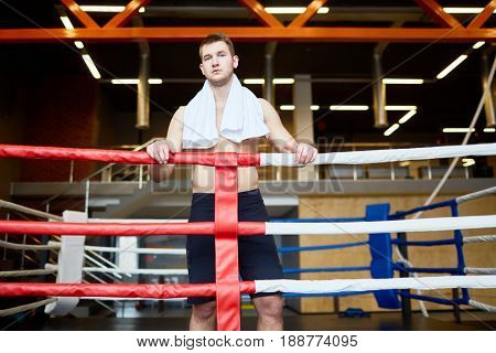 Mixed martial arts fighter standing inside boxing-ring