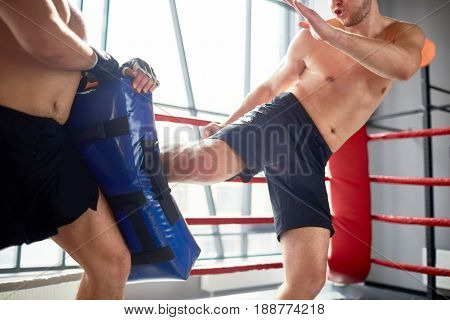 Kick-boxing fighter training with instructor