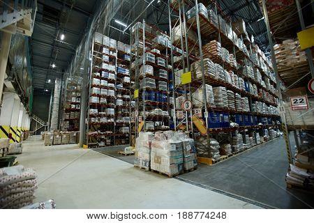 Packed goods for wholesale on shelves of storehouse