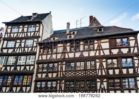 STRASSBOURG, FRANCE- CIRCA MARCH, 2017: Old historic facades of half-timbered houses in Strasbourg, Alsace, France viewed looking up from below in a travel and tourism or architecture concept