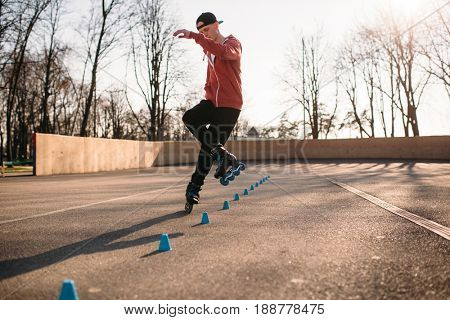 Roller skater, trick exercise in park