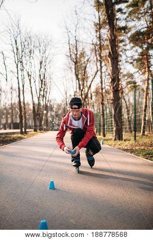 Roller skater in skates, balance exercise