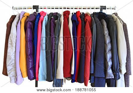 Women coat and jacket on hangers isolated over white background