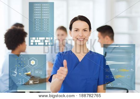 medicine, healthcare, technology and people concept - happy female doctor or nurse over group of medics meeting at hospital showing thumbs up gesture