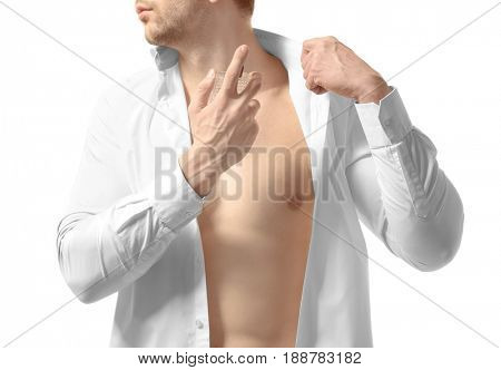 Man using perfume on white background