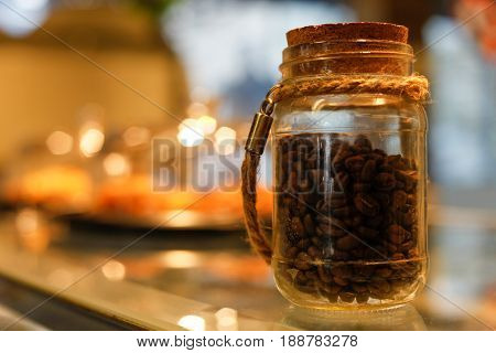 Jar of coffee beans in a trendy café.