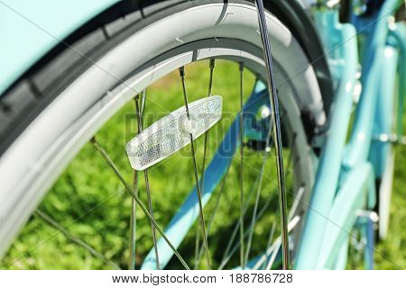 Closeup view of bicycle wheel spokes on blurred background