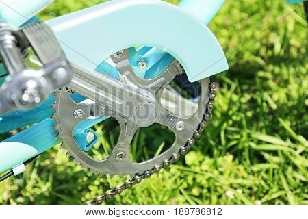 Closeup view of bicycle crank set on blurred background