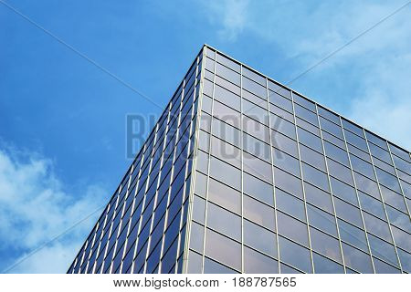 Building with tinted windows against blue sky