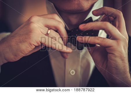 Man tying custom made bowtie
