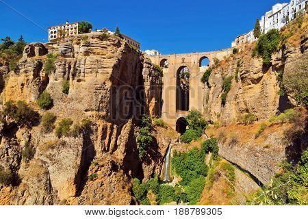 18th Century arched bridge over the El Tajo gorge in Ronda, Andalucia, Spain