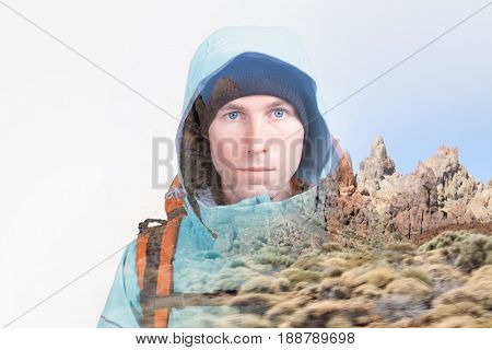 Face of young man hiker and volcanic rock formations on the island Tenerife, the volcano Teide. Double exposure effect photography.