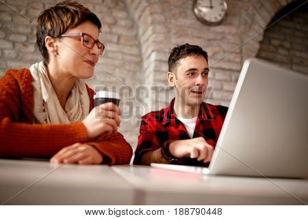 young architect couple working late at computer in office