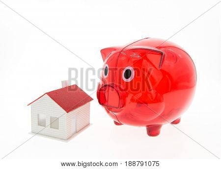 piggy bank and a house on white background