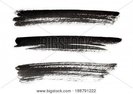 Set of black long ink strokes isolated on the white background