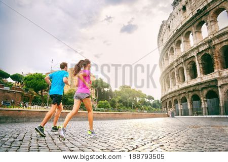 Runners running next to colosseum in Rome city, Italy, Europe travel destination. Healthy active people lifestyle.