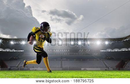 Football player at stadium. Mixed media