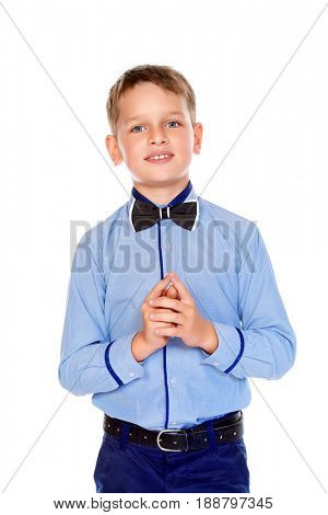 Portrait of a cute smiling nine year old boy in elegant shirt and bow-tie. Kid's fashion. Education. Isolated over white background. Copy space.