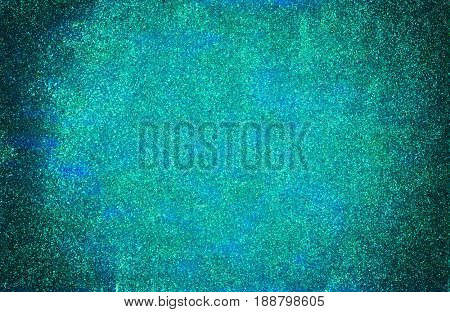 Background made of mermaid blue glitter nail polish and blue craft foam