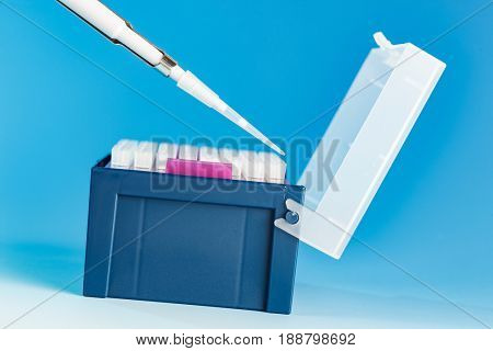 Pipette Tips in rack, A pipette or pipet is a laboratory tool used for chemistry, biology and medicine to transport and  measure  liquid