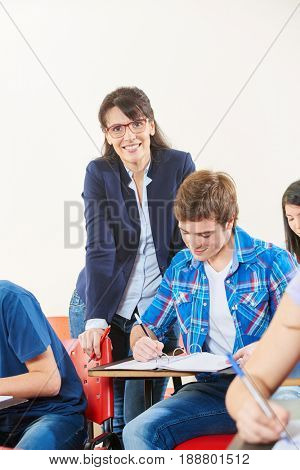 Teacher supervises her students during a test at school