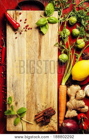 Herbs and spices. Fresh delicious ingredients for healthy cooking on rustic background, top view. Diet, cooking, clean eating or vegetarian food concept.