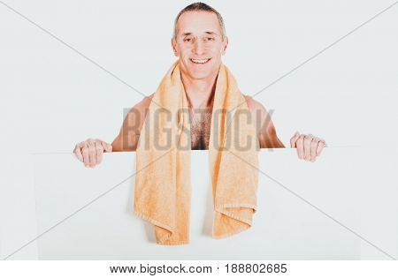 Man with towel around neck holding empty banner