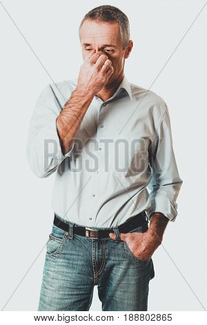 Man holding his nose because of sinus pain