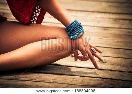 woman hand in yoga symbolic gesture mudraoutdoor shot closeup