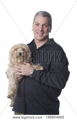 Caucasian man holding dog