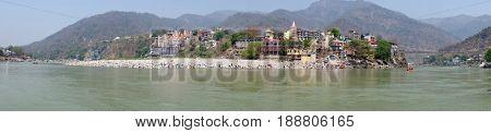 Panorama from the river Ganga near Laxman Jhula in India