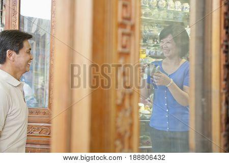 Older Chinese couple shopping together