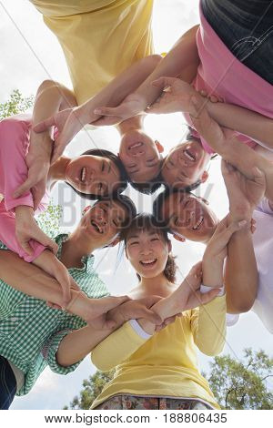Group of Chinese friends smiling together