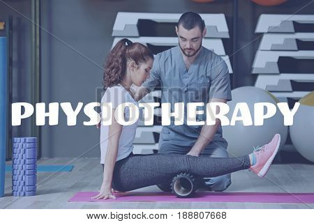 Physiotherapy concept. Physiotherapist working with patient in rehabilitation center