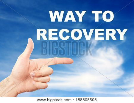 Rehabilitation concept. Young man pointing WAY TO RECOVERY on sky background