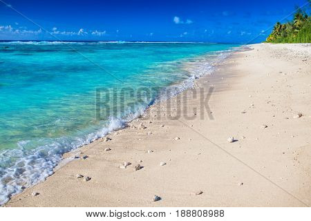 Detail of waves on deserted beach of tropical Rarotonga, Cook Islands, South Pacific