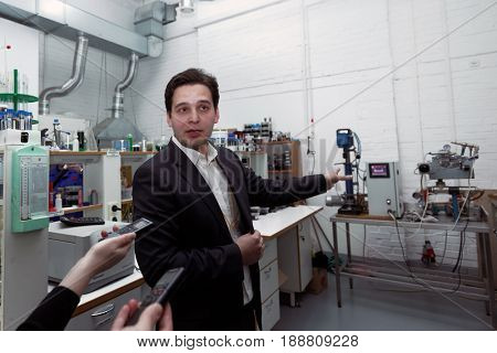ST. PETERSBURG, RUSSIA - APRIL 28, 2017: Manager of VMPAUTO enterprise in the laboratory during the press tour to the production of lubricants. The company exports products to 35 countries