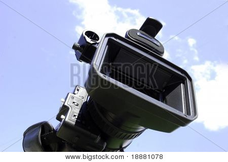 professional HDV camcorder isolated on sky