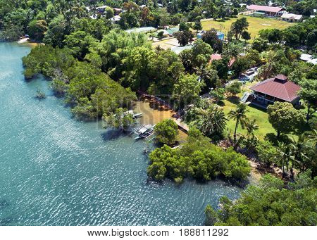Aerial view of coast with village and mangroves. Busuanga, Palawan May 2017