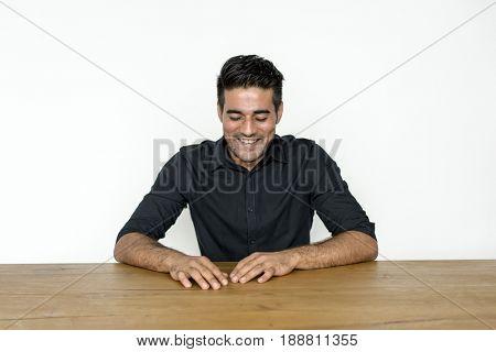 Man Sitting Optimistic Smiling Alone