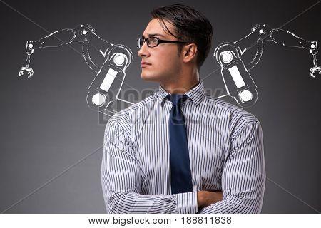Businessman man with robotic arms