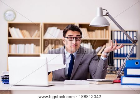 Businessman receiving letter envelope in office